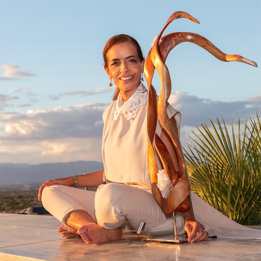 Sculptor Dorit Schwartz with Blooming of the Spirit art piece